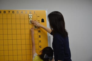 Instructors should change activities from a match to others such as Tsume Shogi (Shogi puzzles) when girls hate to engage in a match.
